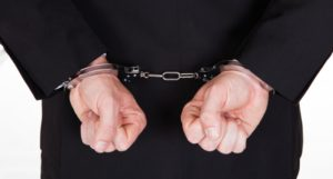 pastor-in-black-wearing-handcuffs-via-shutterstock-800x430